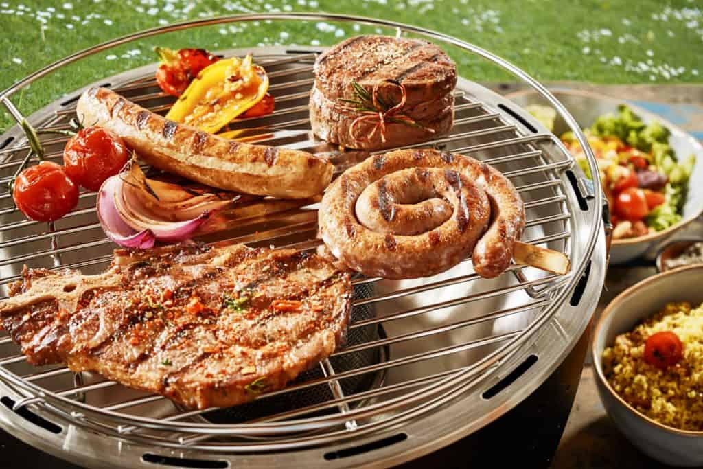 assorted grilled meat on a gas barbecue