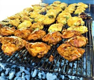 bbq grilled chicken thighs over charcoal