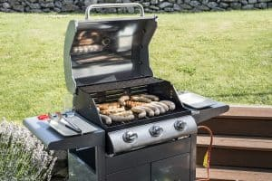 bbq on propane gas grill steaks bratwurst sausages