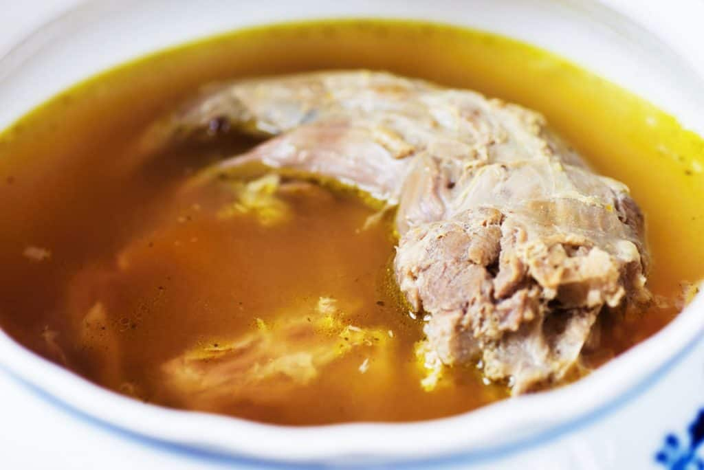 bowl with turkey broth and neck