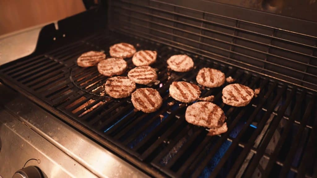 burgers cooking on gas grill