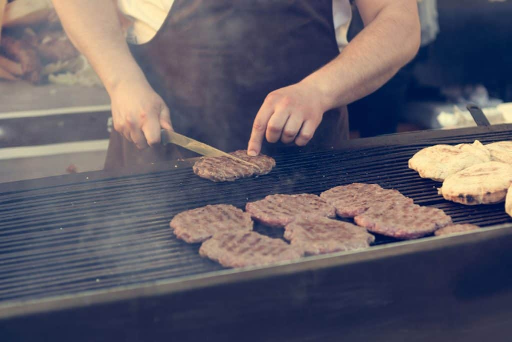 burgers grilled on charcoal BBQ grill