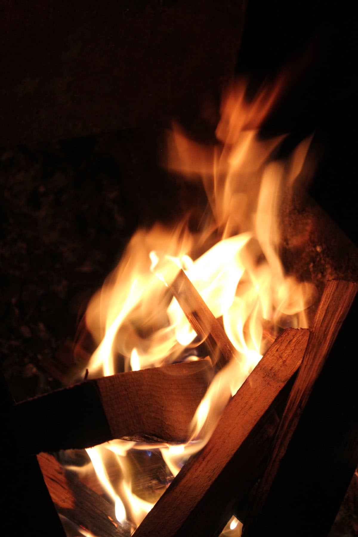 burning wood chips in charcoal grill