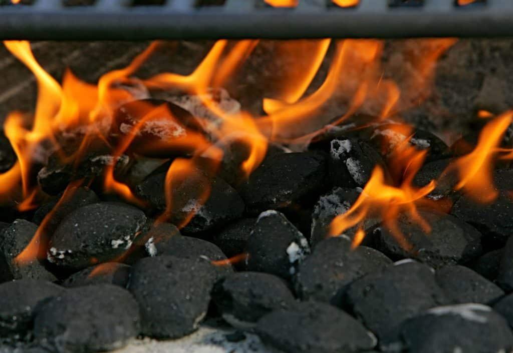 charcoal briquettes and flames