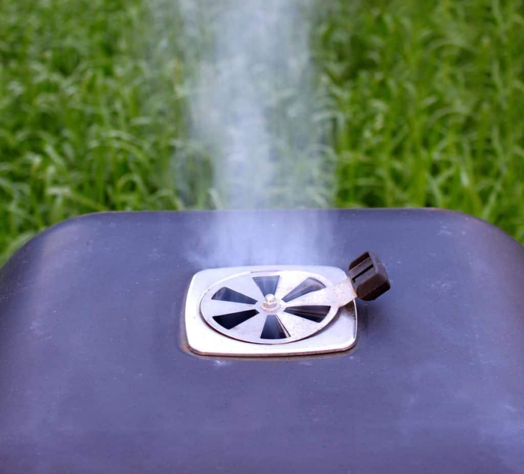 charcoal offset smoker during backyard cookout