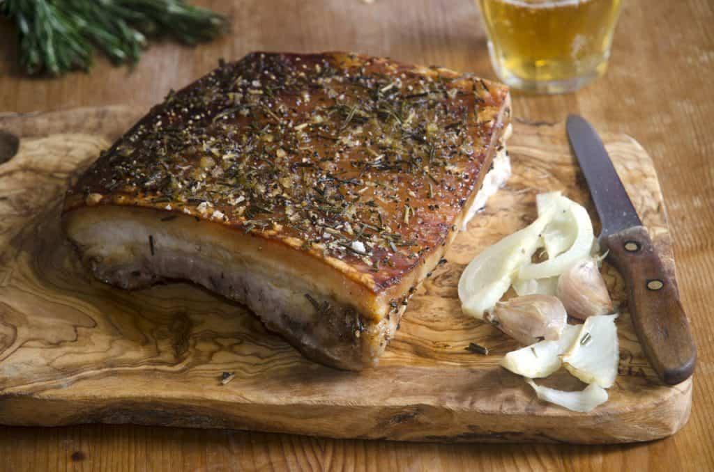 crispy pork belly with garlic on a cutting board