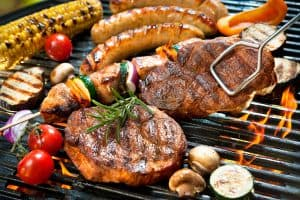 delicious grilled meat and vegetables on a barbecue