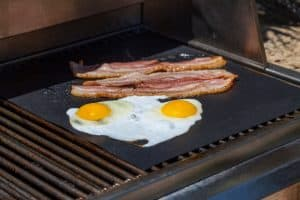 Eggs and Bacon Breakfast on the Grill Outside