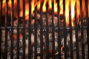 empty barbecue grill with glowing charcoal