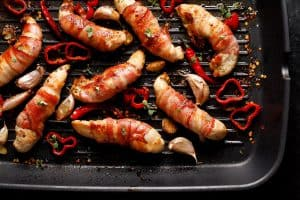 grilled chicken tenderloin wrapped with bacon with addition chili peppers garlic and herbs
