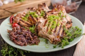 grilled pork chops with caramelized onion and herbs