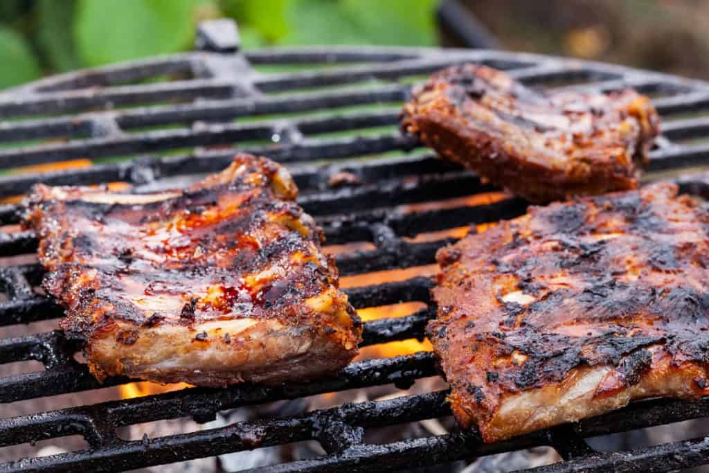 grilling pork spareribs on barbecue grill