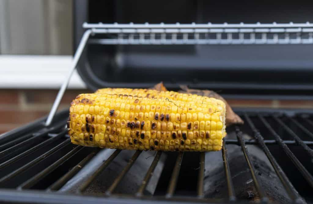 grilling sweet corn and sweet potato on gas grill