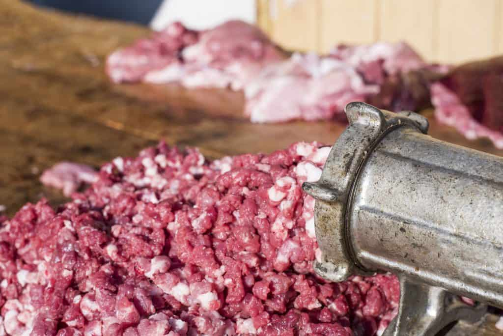iron meat grinder grinding beef