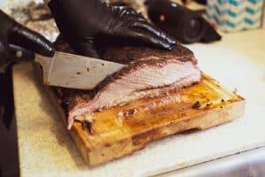 juicy beef brisket on chopping block