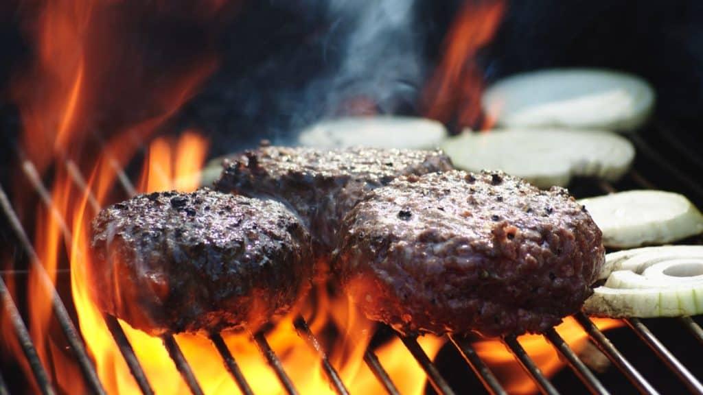 juicy burger patties on flame