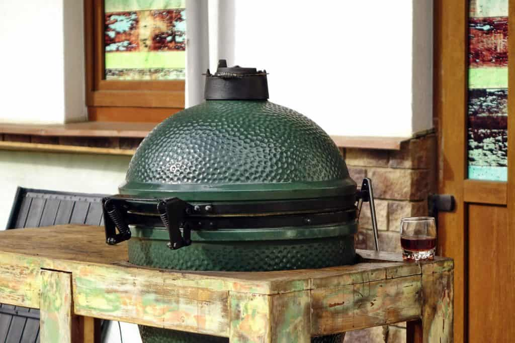 kamado grill green ceramic mounted in the table