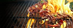 marinated spicy pork ribs grilling on a bbq