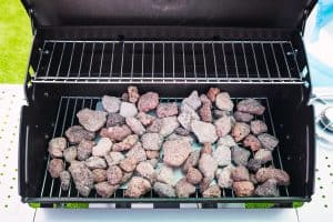 new and clean barbecue grill with lava rocks