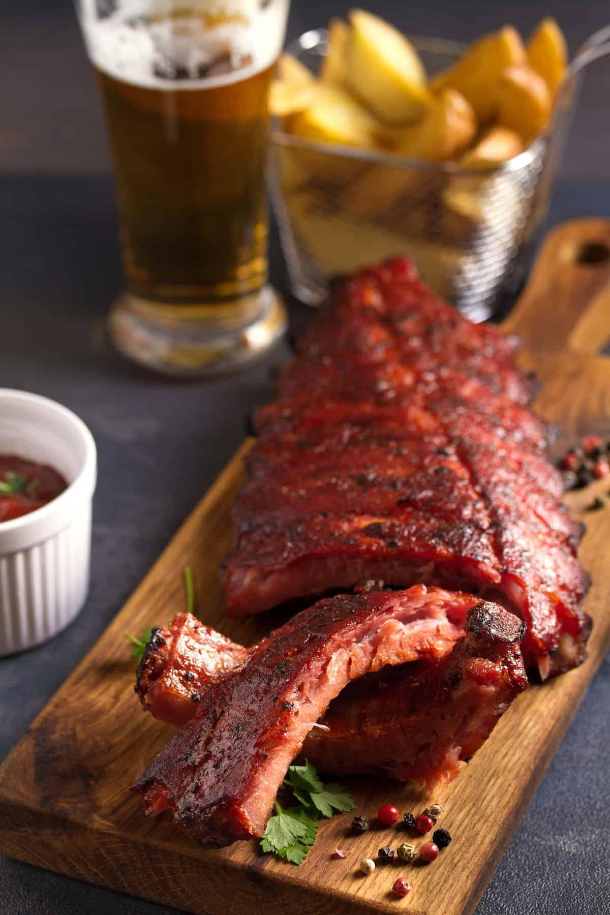 pork loin ribs served on chopping board
