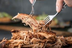 pulling pork with 2 forks