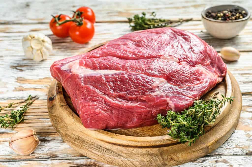 raw brisket beef cut on a wooden board black angus beef