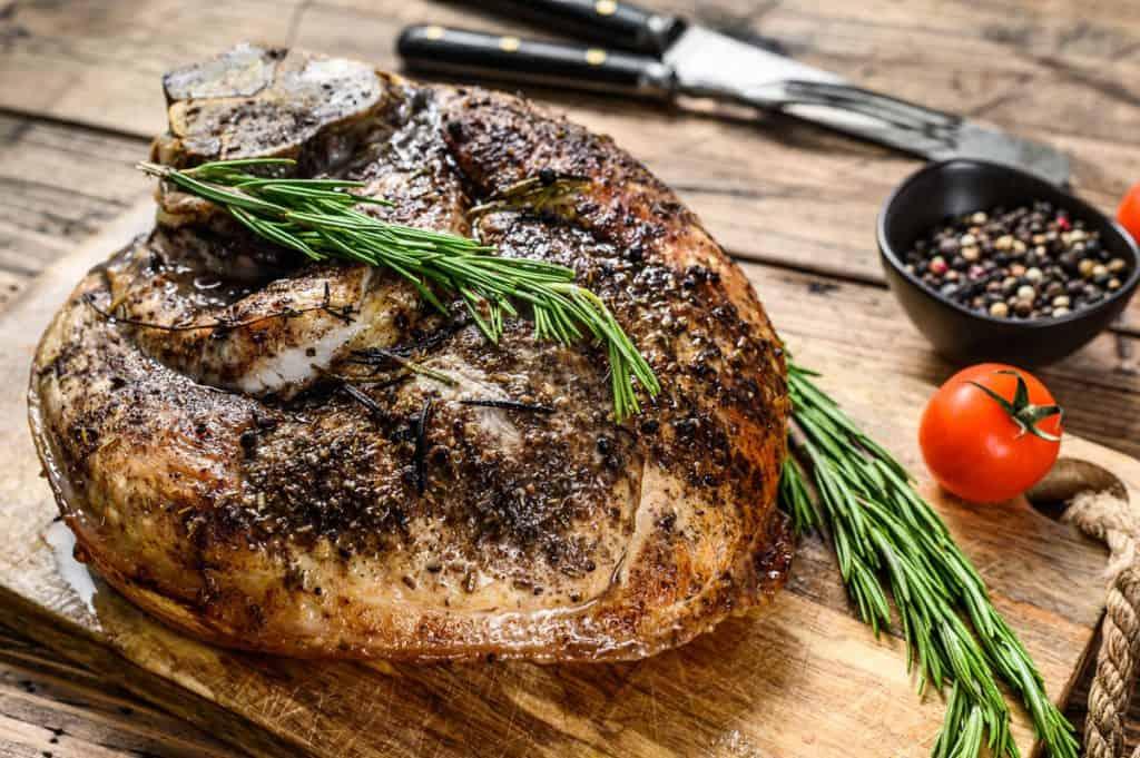 roasted pork ham on a cutting board shank meat