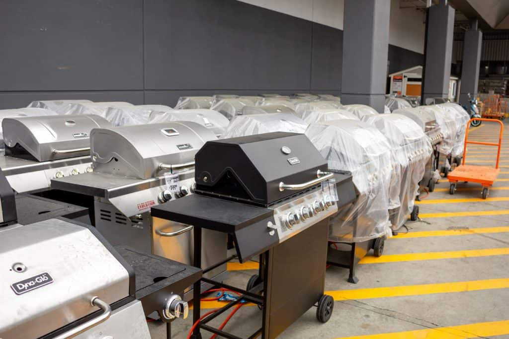 several propane powered barbecue grills on display