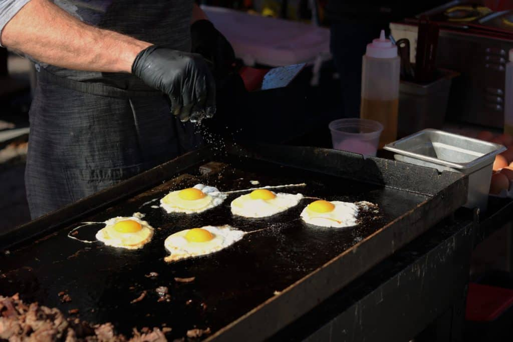 sunny side up eggs and steak on griddle