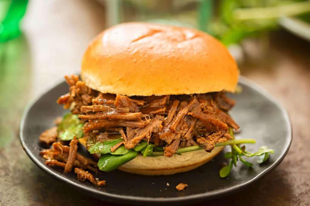 sweet bun barbecue beef brisket bun with watercress leaves
