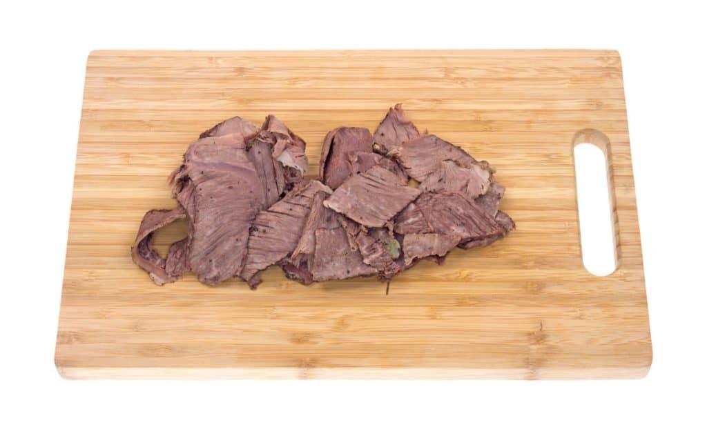 thin sliced chuck roast on cutting board