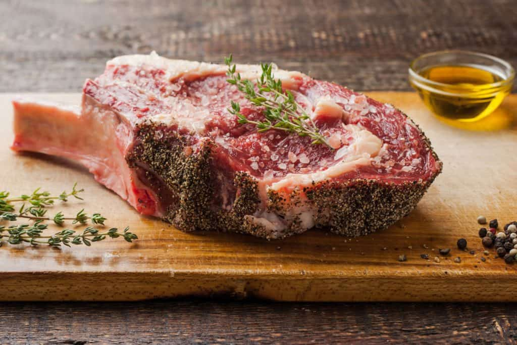 tomahawk steak on the bone with thyme